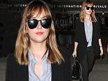 """Los Angeles, CA - Dakota Johnson lands at LAX from Paris. The 26-year-old actress looks sophisticated in black skinny jeans and a blue button up paired with a blazer and Gucci loafers. Dakota has been busy at work on set of the latest """"Fifty Shades"""" movie in Paris. \nAKM-GSI          July 21, 2016\nTo License These Photos, Please Contact :\nMaria Buda\n(917) 242-1505\nmbuda@akmgsi.com\nsales@akmgsi.com\nor \nMark Satter\n(317) 691-9592\nmsatter@akmgsi.com\nsales@akmgsi.com\nwww.akmgsi.com"""