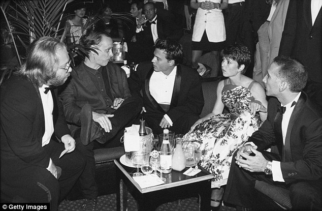 At his side: Christi Dembrowski was pictured beside Depp in 1995 at a party for the film Ed Wood in Cannes. She is close to Depp, and was said to side with his mother against Heard