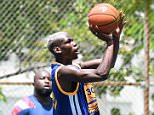July 20, 2016: Footballer Paul Pogba plays basketball for a second day in a row while cheered on by a bevy of girls including the girl he embraced earlier in the day in Miami Beach, Florida.  Mandatory Credit: INFphoto.com Ref: infusmi-20/21