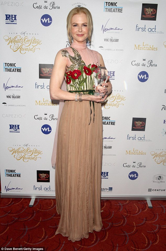 Stunner: The red head beauty shows of her svelte figure in a flowing floral gown at the WhatsOnStage Awards at The Prince of Wales Theatre, London Read more