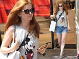 EXCLUSIVE: Isla Fisher was seen hitting all the trendy boutiques on July 20 in Hampstead High Street. Isla wore a Mickey mouse printed  t-shirt and Daisy Duke Denim shorts.\n\nPictured: Isla Fisher\nRef: SPL1314859  210716   EXCLUSIVE\nPicture by: Splash News\n\nSplash News and Pictures\nLos Angeles: 310-821-2666\nNew York: 212-619-2666\nLondon: 870-934-2666\nphotodesk@splashnews.com\n