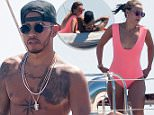 20.July.2016 - St Tropez - France\nBritish Formula One driver Lewis Hamilton taking a break from his racing duties by soaking up the french sunshine on holiday in St Tropez and is joined by a sexy brunette on board his yacht.\n*** AVAILABLE FOR UK SALE ONLY ***\nBYLINE MUST READ : E-PRESS / XPOSUREPHOTOS.COM\n***UK CLIENTS - PICTURES CONTAINING CHILDREN PLEASE PIXELATE FACE PRIOR TO PUBLICATION ***\n**UK CLIENTS MUST CALL PRIOR TO TV OR ONLINE USAGE PLEASE TELEPHONE 0208 344 2007**