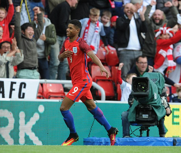 Marcus Rashford celebrates after he put England ahead in the first half after just 138 seconds on Friday night
