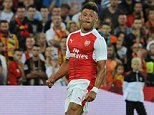 LENS, FRANCE - JULY 22:  Alex Oxlade-Chamberlain chips the ball over Lens goalkeeper Douchez Nicolas to score the Arsenal goal during a pre season friendly between RC Lens and Arsenal at Stade Bollaert-Delelis on July 22, 2016 in Lens.  (Photo by Stuart MacFarlane/Arsenal FC via Getty Images)