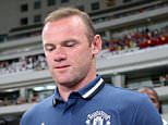 epa05436709 Wayne Rooney of Manchester United walks into the stadium with teammates for a soccer match against Borussia Dortmund in the 2016 International Champions Cup in Shanghai, China Friday July 22, 2016. Rooney did not play.  EPA/STR CHINA OUT