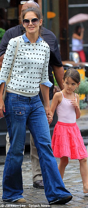 Puddle jumpers: The 33-year-old wore a polka-dot jumper and 1970's style jeans, while her mini-me dressed lightly in a pink tank top and knee-length skirt