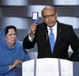 Khizr Khan, father of fallen US Army Capt. Humayun S. M. Khan holds up a copy of the Constitution of the United States as his wife listens during the final day of the Democratic National Convention in Philadelphia , Thursday, July 28, 2016. (AP Photo/J. Scott Applewhite)
