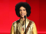 FILE - In this Nov. 22, 2015 file photo, Prince presents the award for favorite album - soul/R&B at the American Music Awards in Los Angeles. Prince¿s family says an official tribute concert honoring the late icon will take place on October 13, at the U.S. Bank Stadium in Minneapolis. Prince was found dead at his home on April 21, 2016, in suburban Minneapolis. He was 57. (Photo by Matt Sayles/Invision/AP, File)