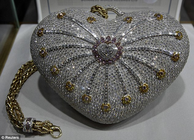 Worth its weight in gold: The Mouawad 1001 Nights Diamond Purse is valued at £2.35 million