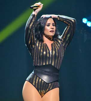 Taking to the stage: Demi Lovato looked incredible as she performed at the Allstate Arena in Illinois.