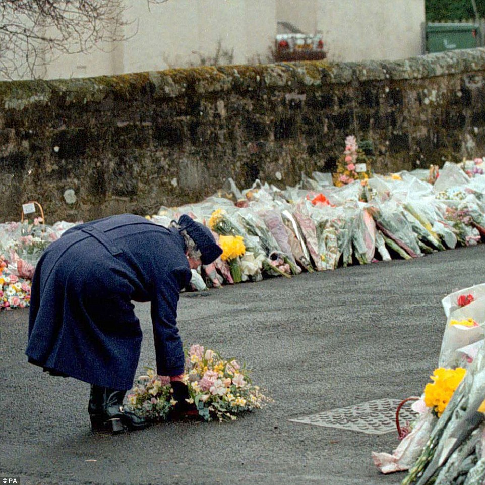 Memorial: Queen Elizabeth II laying a wreath at the gates of Dunblane Primary School on March 17, 1996, after one of the deadliest firearms incidents in UK history. Gunman Thomas Hamilton killed sixteen children and one teacher at the school near Stirling, Scotland, on March 13, before committing suicide