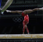 United States' Gabrielle Douglas trains on beam as a coach looks on, ahead of the 2016 Summer Olympics in Rio de Janeiro, Brazil, Thursday, Aug. 4, 2016. (AP Photo/Rebecca Blackwell)