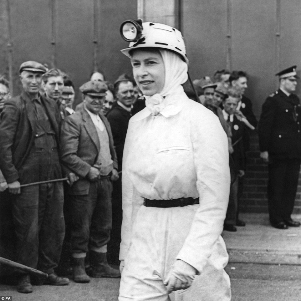 Dressed for the mines: The Queen dressed in a white boiler suit, scarf and safety helmet on a visit to the coal mine at Rothes Colliery in Fife on July 1, 1958. It was her first visit to a coal mine and she spent around 30 minutes underground visiting the coal face