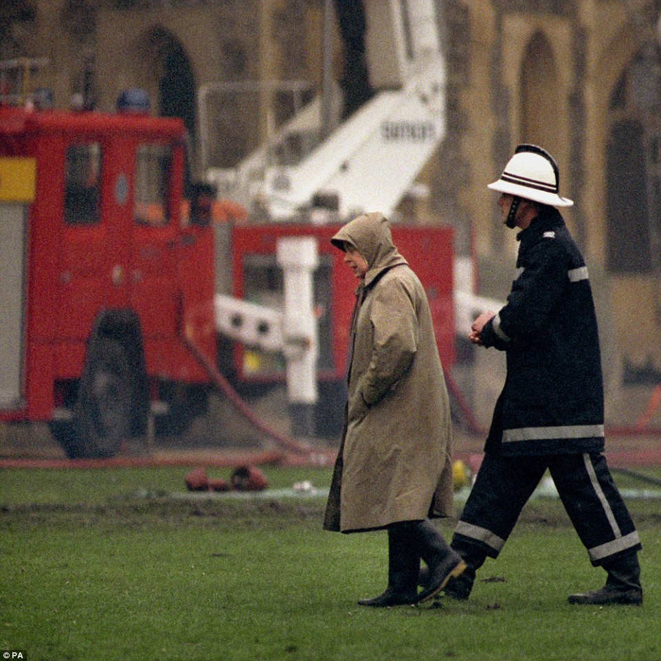 Rough patch: Queen Elizabeth II surveying the scene at following the fire at Windsor Castle on November 21, 1992. This year was dubbed her 'annus horribilis' by the Queen herself, as 1992 also saw the Princess Royal divorce, the Duke and Duchess of York separate and the Prince and Princess of Wales's relationship hit rock bottom