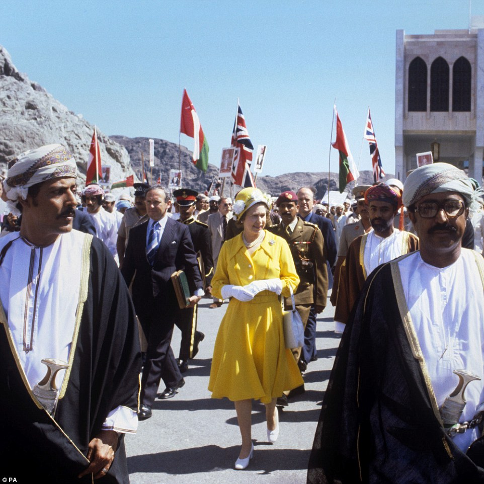 Royal entourage: Queen Elizabeth II is pictured in a bright yellow outfit during a walkabout in Muscat while visiting Oman on March 2, 1979