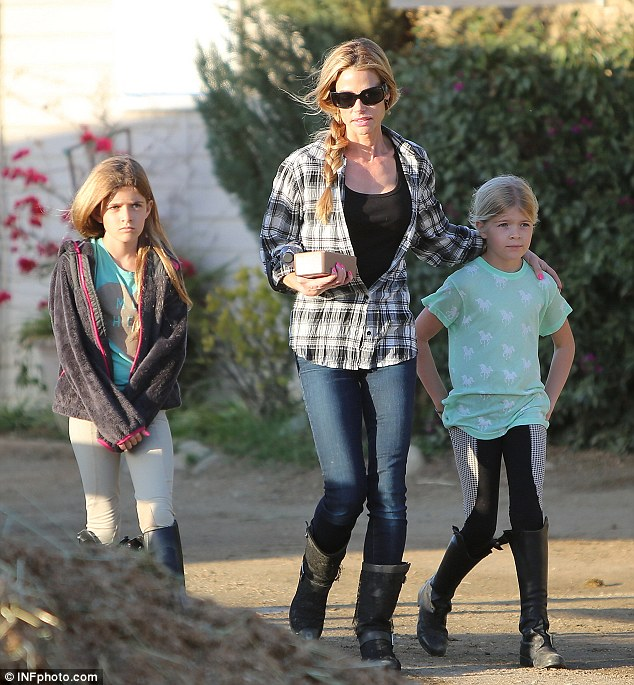Fight continues: Charlie Sheen is reportedly taking Denise Richards, pictured last week, to mediation to reduce child support payments for their daughters Sam and Lola