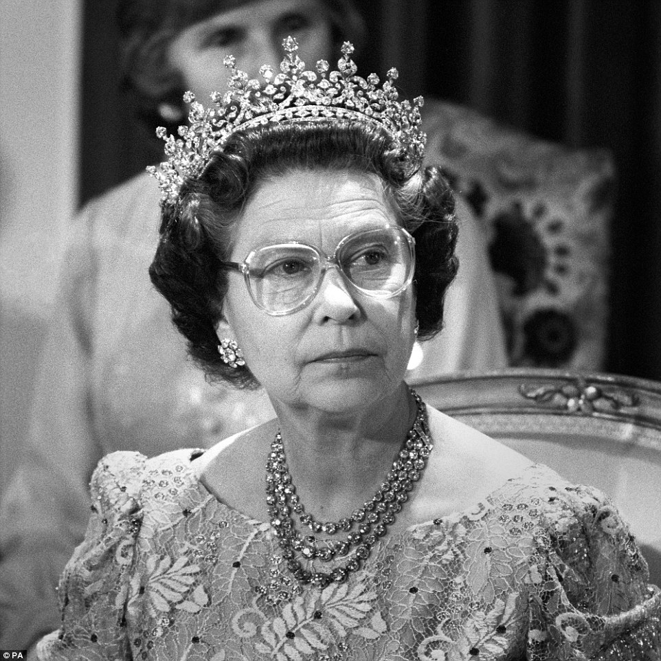 Regal: The Queen at a reception and banquet in Berlin's Charlottenburg castle after arriving with the Duke of Edinburgh for a two-day visit to join in the city's 750th anniversary celebrations on May 25, 1987. She was first pictured wearing reading glasses in 1977