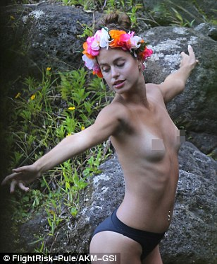 Free as a bird! The brunette beauty stripped off and stretched out his arms as she posed up a storm on the cliff face