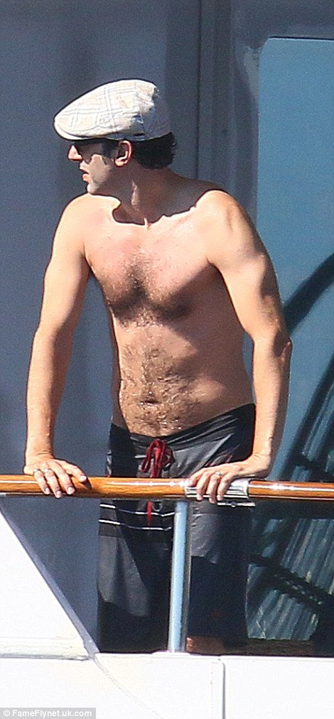Isla Fisher and her husband Sacha Baron Cohen were seen soaking up the Cannes sunshine on board their friend's luxury vessel on Saturday