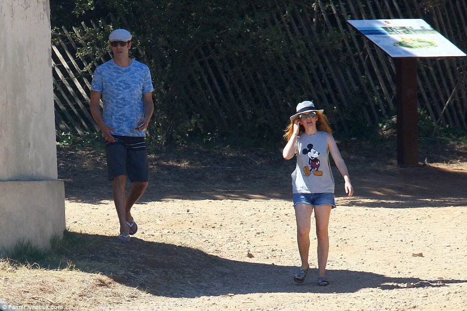 This way! Isla took the lead as she strolled around in the searing heat with her husband lagging behind