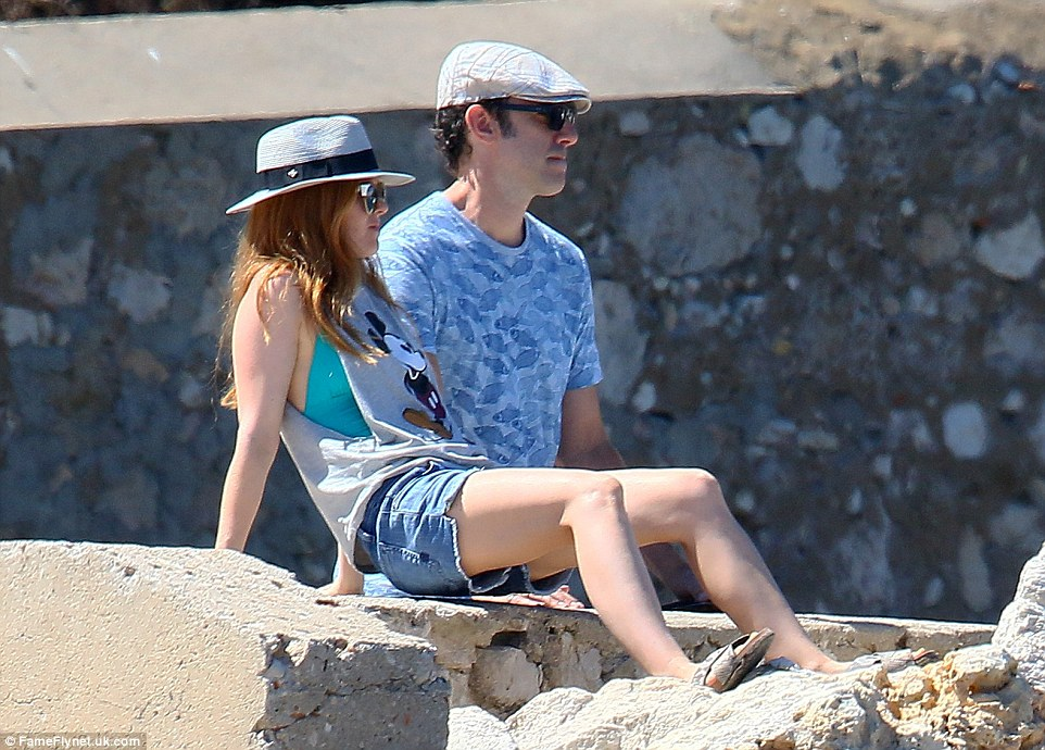 Taking a break: The pair sat down and observed their beautiful surroundings as they enjoyed their latest holiday