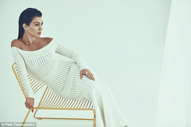 KOURTNEY WEARS DRESS, Barbara Casasola. NECKLACE and RING (right hand), Maria Black. RING (left hand), Maria Francesca Pepe. EARRINGS, Kourtney's own