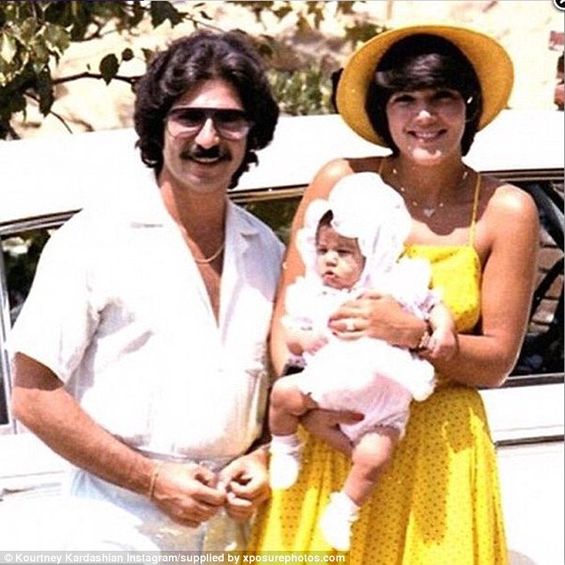 Kourtney as a baby with her parents Robert and Kris