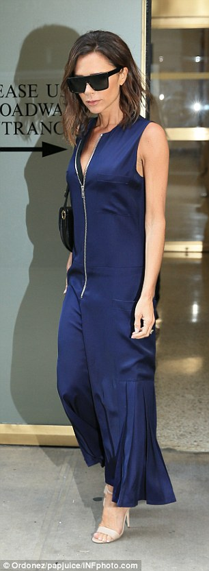 Fashion forward: Victoria teamed the jumpsuit with a simple pair of nude strappy sandals as she teetered around the city