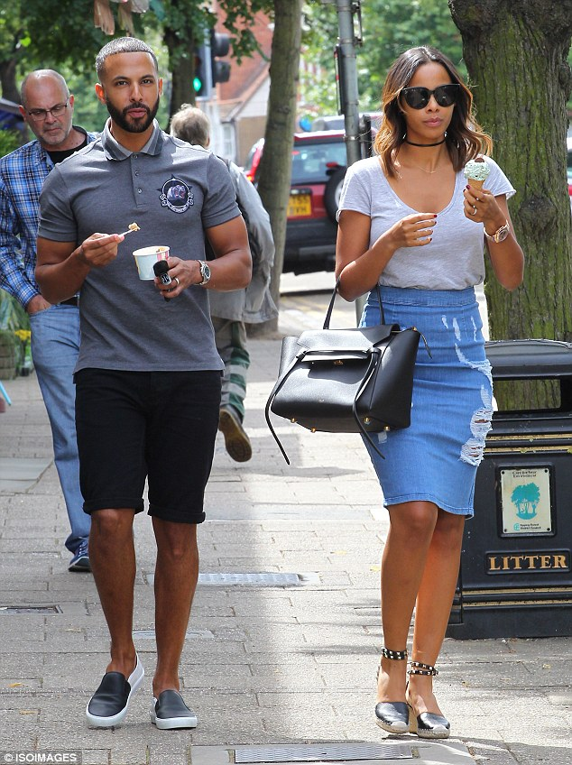 Cooling off: Rochelle and Marvin Humes decided to make good use of Britain's rare warm spell as they enjoyed some ice-cream in Essex on Saturday