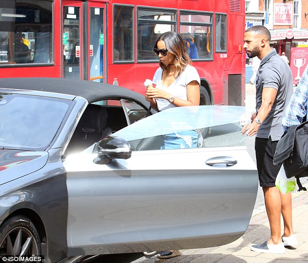 Chivalrous: Marvin opened the door as Rochelle got in the vehicle