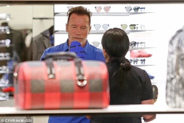 Eye for luxury:Arnold clearly has great taste - the former body builder was also spotted taking Prada by storm