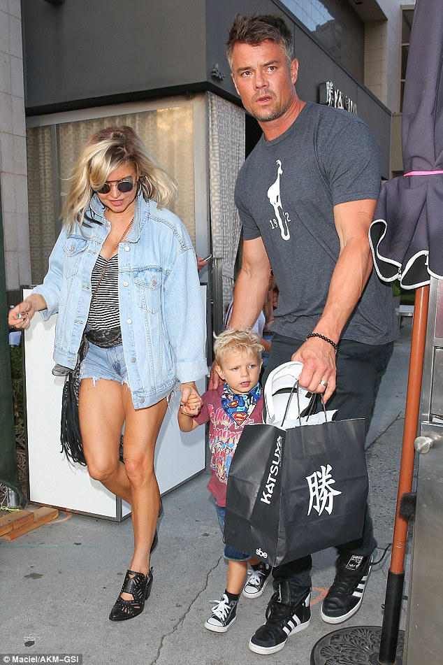Signature edgy style:Fergie's outfit consisted of a baggy jean jacket, quirky black heels, and frayed shorts that highlighted her extremely toned legs to full effect