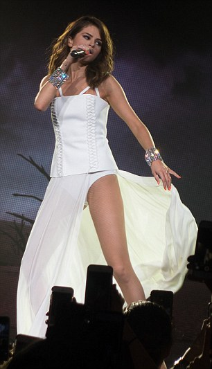 Flaring out: Selena was able to hold onto the fabric and move it around while singing