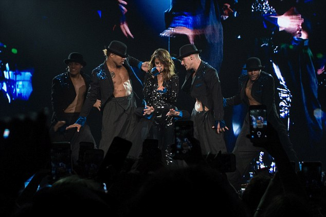 Working it: Selena immersed herself into the performances, with the male dancers surrounding her