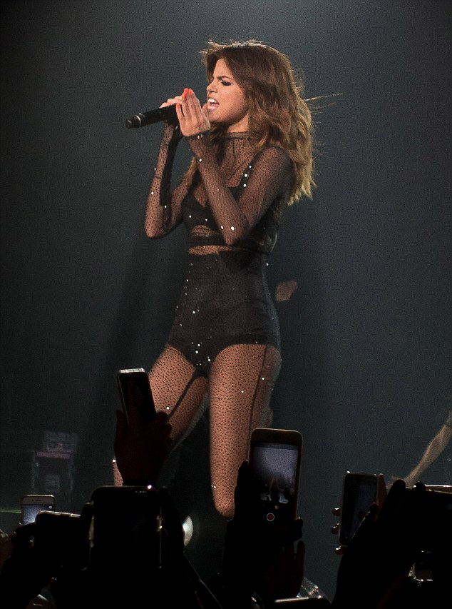 Sheer daring: The Good For You singer also dared to bare in a black ensemble