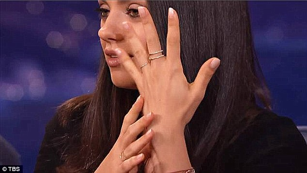 Showing it off: She said on Conan: 'Mine is 1mm platinum and his is 2mm yellow gold and made by a wonderful little old lady'