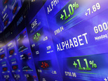 FILE - In this Monday, Feb. 1, 2016, file photo, electronic screens post prices of Alphabet stock at the Nasdaq MarketSite in New York. Business is booming at Google¿s parent company, Alphabet Inc., even as it loses billions of dollars on risky projects that may never produce any revenue. (AP Photo/Mark Lennihan, File)