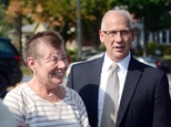 FILE - In this Sept. 3, 2015 file photo, Sharon and Randy Budd talk with friends and relatives outside the Union County Court House in Lewisburg, Pa., after three young men were sentenced to time behind bars for throwing a rock off a highway overpass in central Pennsylvania, causing severe brain trauma to Sharon, an Ohio teacher. Randy Budd, has died at age 55. Harry Campbell, chief investigator for the Stark County Coroner¿s office, told The Associated Press on Sunday, Aug. 7, 2016, that Budd died of a self-inflicted gunshot wound and was pronounced dead at his Uniontown, Ohio, home late Saturday. (Amanda August/The Daily Item via AP, File)
