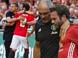 Juan Mata of Manchester United is substituted off and replaced by Manchester United manager Jose Mourinho during the FA Community Shield match between Leicester City and Manchester United played at Wembley Stadium, London on August 7th 2016