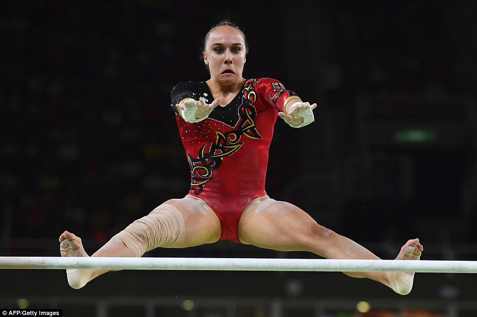 Tabea Alt of Germany looks extremely worried as she springs from an Uneven Bar at the Olympic Games event