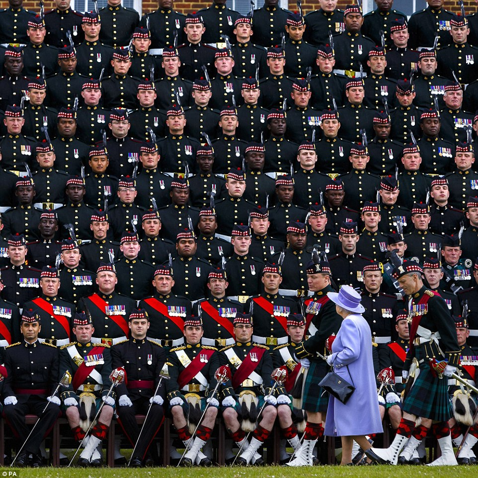 Group shot: Elizabeth II joining The Argyll & Sutherland Highlanders, 5th Battalion, Royal Regiment of Scotland (5 SCOTS) for a photograph during her visit to Howe Barracks in Canterbury, Kent, on June 28, 2013