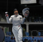 CORRECTS FIRST NAME TO IBTIHAJ FROM UBRIHAJ - Ibtihaj Muhammad from United States, celebrates after winning against Olena Kravatska from Ukraine, during the women's saber individual fencing event at the 2016 Summer Olympics in Rio de Janeiro, Brazil, Monday, Aug. 8, 2016. (AP Photo/Vincent Thian)