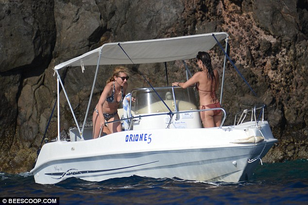 Summer loving: As they continued to sail through the waters she striped off to her bikini