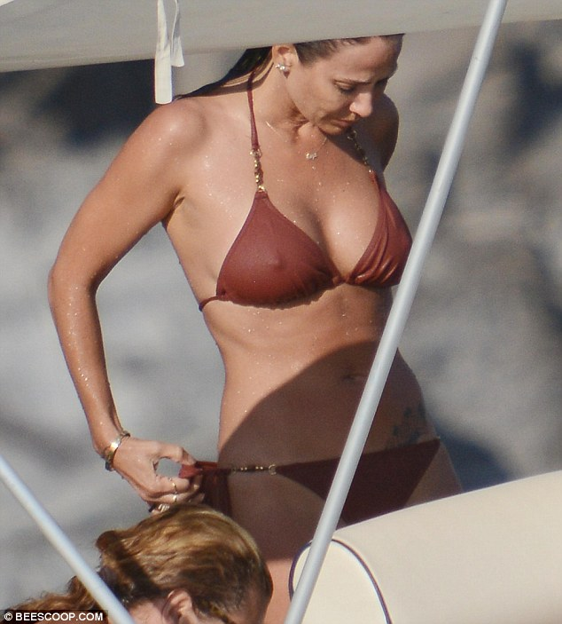 Adjusting: Once on board, she adjusted her bikini to fit in place