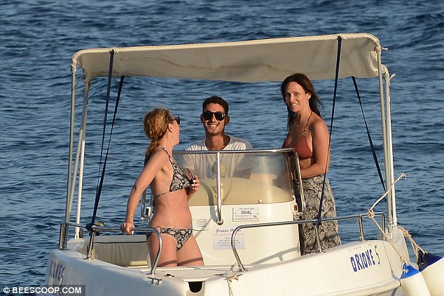 Happy times: Natalie displayed a big smile as she spoke to her close friend and driver of the boat
