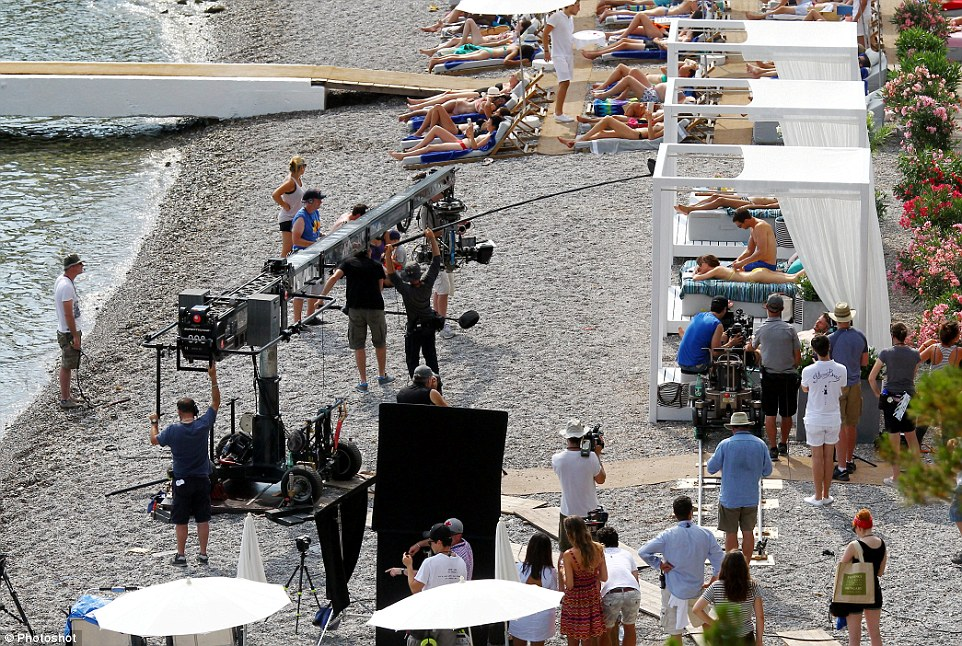 Life's a beach: Dakota gazed out to see while Jamie worked his magic