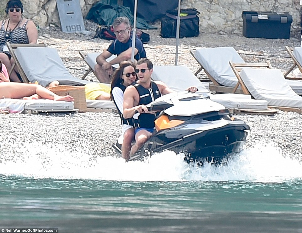Need for speed: Jamie looked to be having a blast as he took Dakota for a ride on a jet ski
