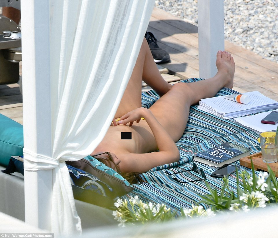 Daring to bare: Dakota stretched out in the shade topless, filming a particularly raunchy scene