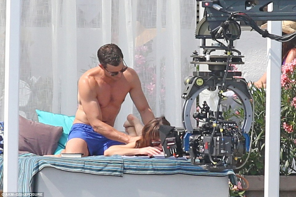 Stress relief: Jamie's muscular arms relieved the tension in Dakota's back as he massaged her
