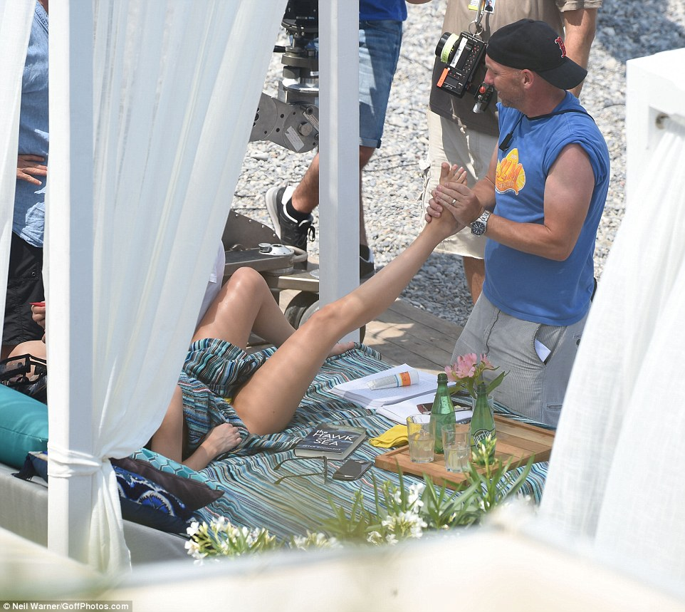 That's the life: Dakota was given a foot massage in between takes